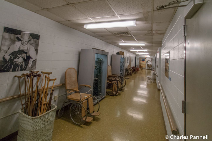 Basement hallway lined with artifacts from the Glore Psychiatric Hospital