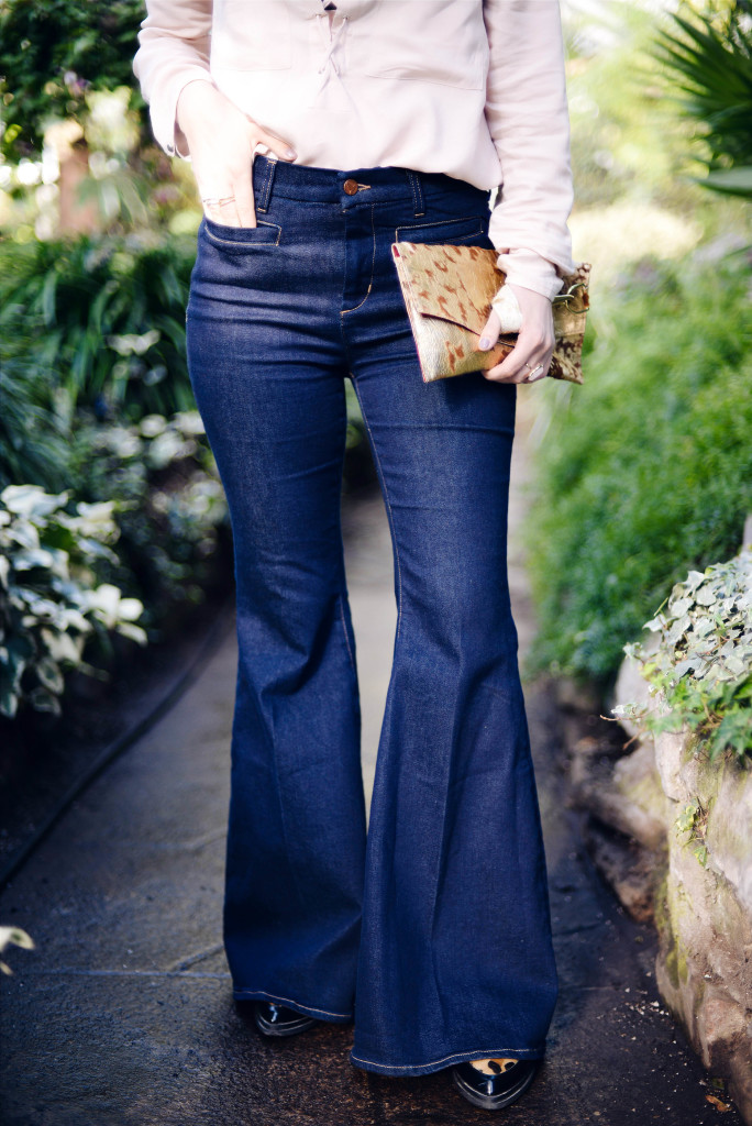 Dark bell bottoms paired with a soft blush top worn by blogger Threads & Blooms