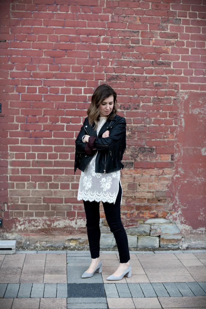 A fringe jacket and lace top