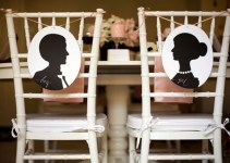 silhouette bride and groom signs