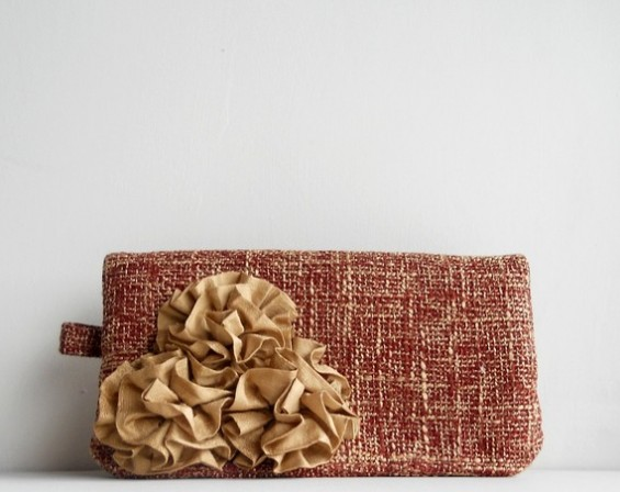 reddish orange clutch purse with rosettes