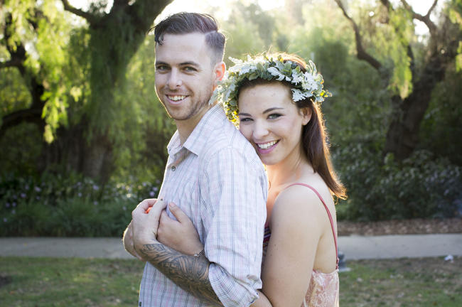 she holds him and they smile at their Santa Fe Springs engagement session
