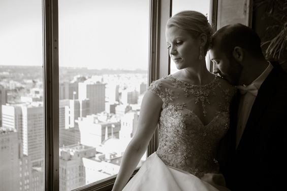 bride and groom overlooking Philadelphia - Crystal Tea Room Wedding - photo: Daniel Fugaciu Photography | via http://emmalinebride.com