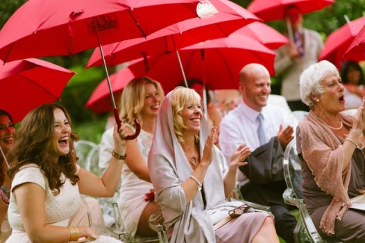 rain during ceremony | photo: adrian wood | real wedding in italy