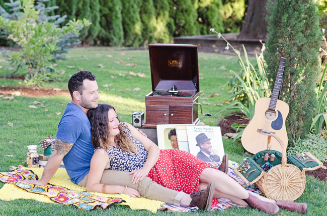 couple on picnic blanket for styled engagement session| Photo: White Ivory Photography | via http://emmalinebride.com/real-weddings/hipster-engagement-session-what-does-one-look-like/