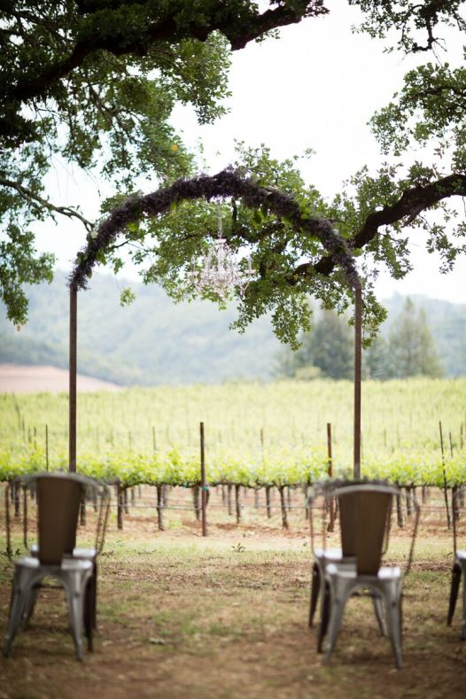 Winery Styled Wedding Shoot - wedding ceremony in winery with chandelier and arch