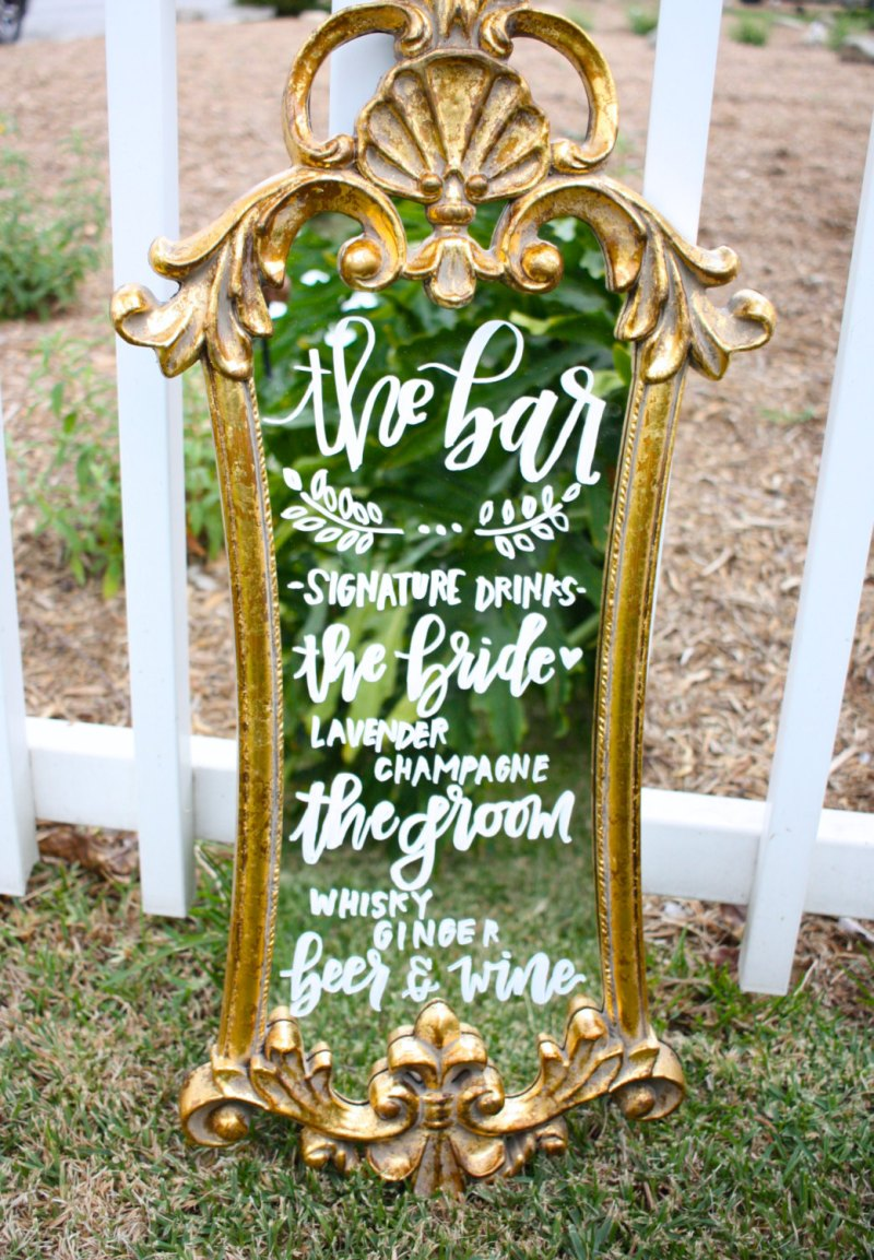 This decorative bar mirror is one of our favorite wedding mirror signs!  It's ideal for displaying a signature cocktail. | http://emmalinebride.com/decor/wedding-mirror-signs/
