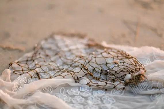 beach wedding veil on sand