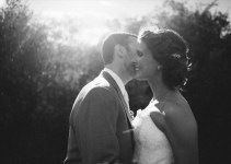 beautiful light groom kissing bride
