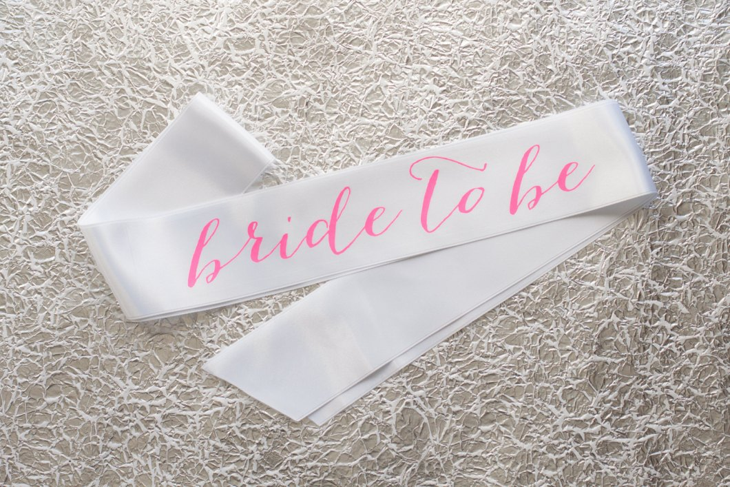 bride to be sash hot pink on white | stylish bachelorette sash ideas | via http://emmalinebride.com/bride/bachelorette-sash-ideas/