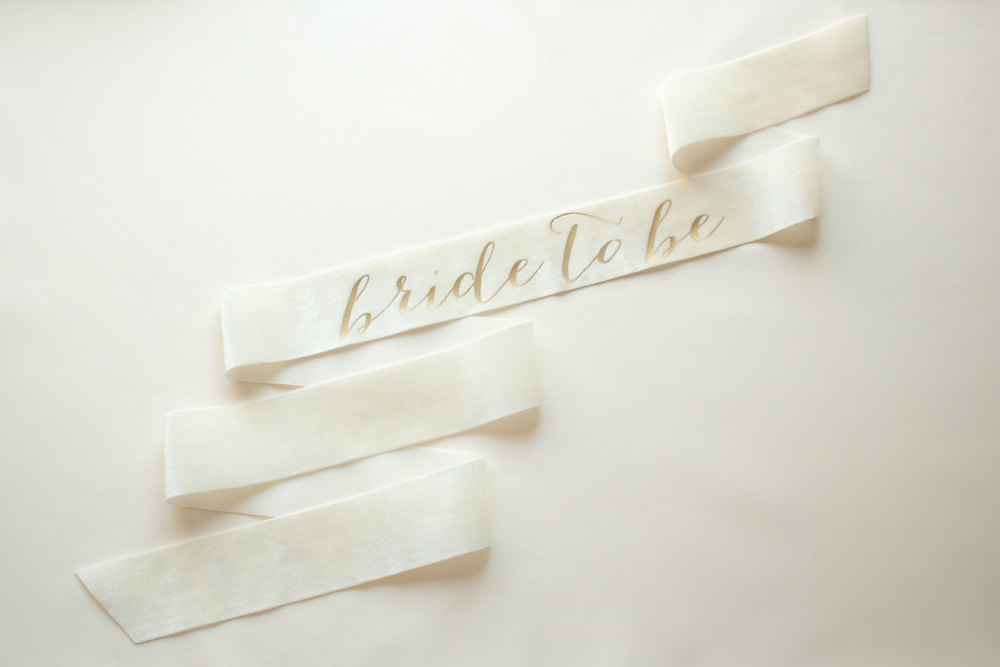 bride to be sash white with gold | stylish bachelorette sash ideas | via http://emmalinebride.com/bride/bachelorette-sash-ideas/