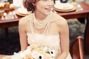 bride wearing layered pearl necklace