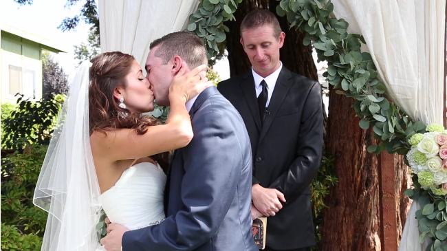 bride and groom kiss at their Sova gardens Wedding film
