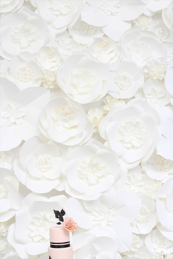 cake with paper flower backdrop
