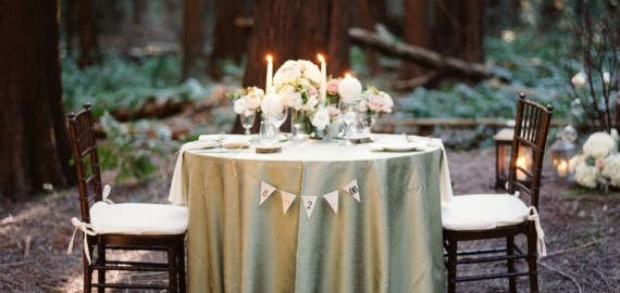 candlelit sweetheart table woods night wedding