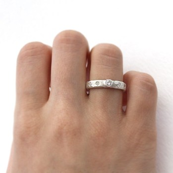 carved diamond ring on hand