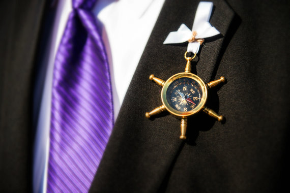 compass boutonniere for nautical wedding | via What Kind of Boutonniere to Pick (and Why) http://emmalinebride.com/groom/what-kind-of-boutonniere/