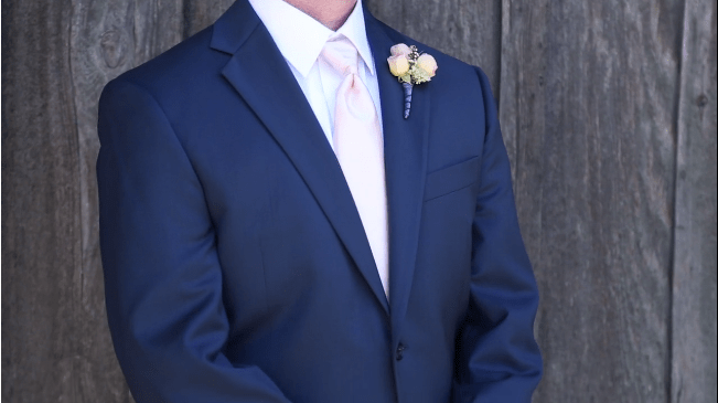 grooms suit and boutineer in their Sova Gardens wedding film