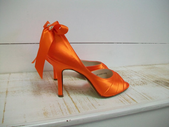 hot orange heels via 30 Amazing Halloween Wedding Ideas from EmmalineBride.com