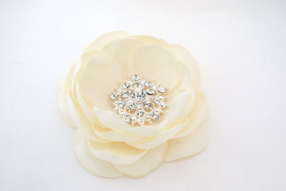 floral bloom with rhinestone center