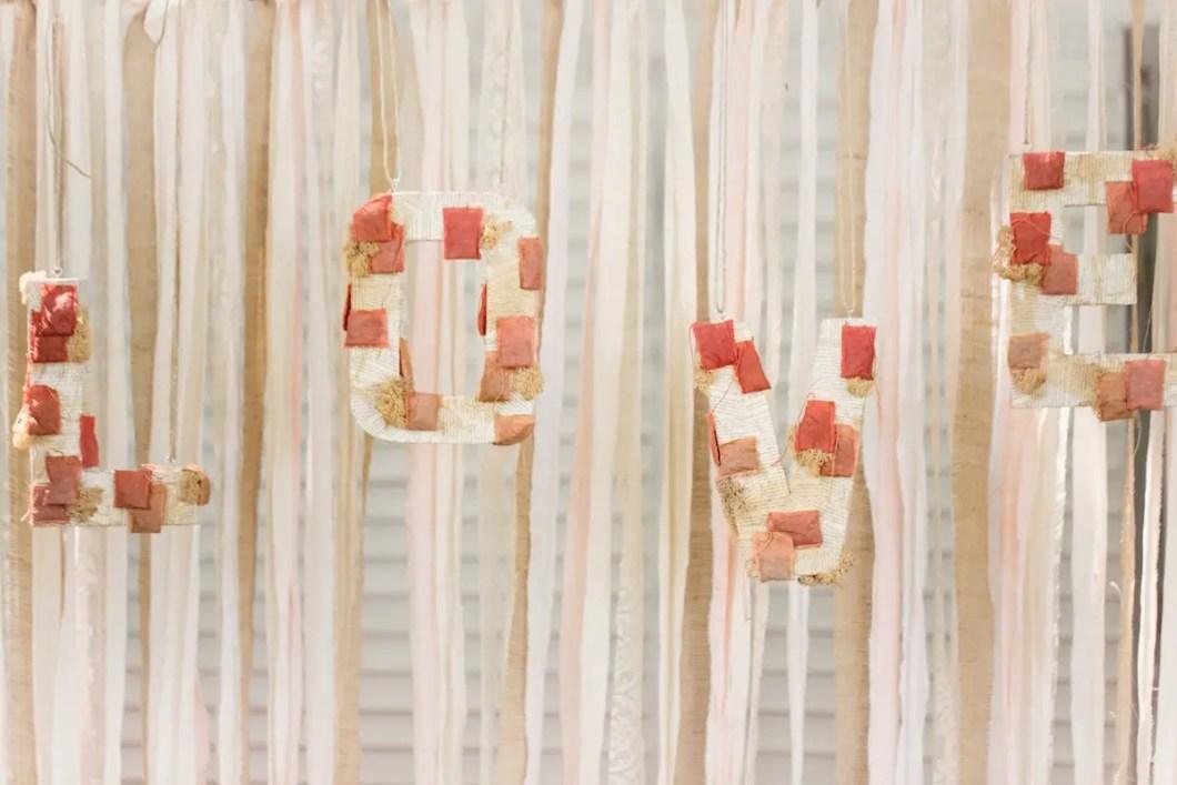 love backdrop with burlap and ribbon | 50 Best Burlap Wedding Ideas | via http://emmalinebride.com/decor/burlap-wedding-ideas/