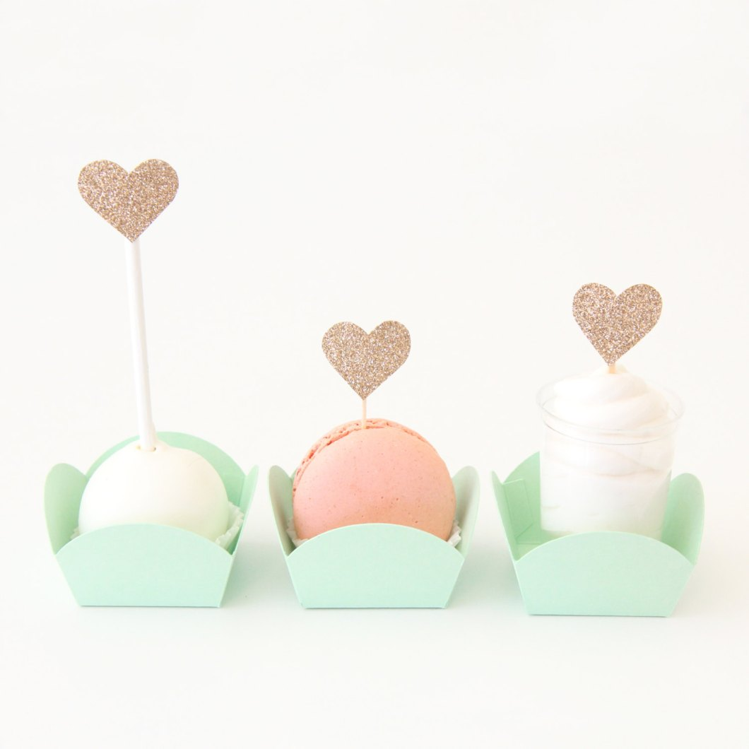 macarons in mint boxes | via 7 Things to Know About Giving Macaron Favors http://emmalinebride.com/favors/giving-macaron-favors/