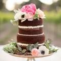 naked wedding cake with peronies, anemones, ranunculus on top