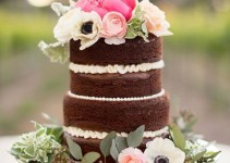 naked wedding cake with peronies, anemones, ranunculus on top