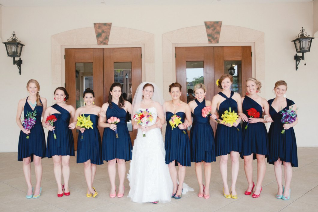 navy blue bridesmaid convertible dresses | via http://emmalinebride.com/bridesmaids/bridesmaid-dress-worn-different-ways/ | love the shoes!