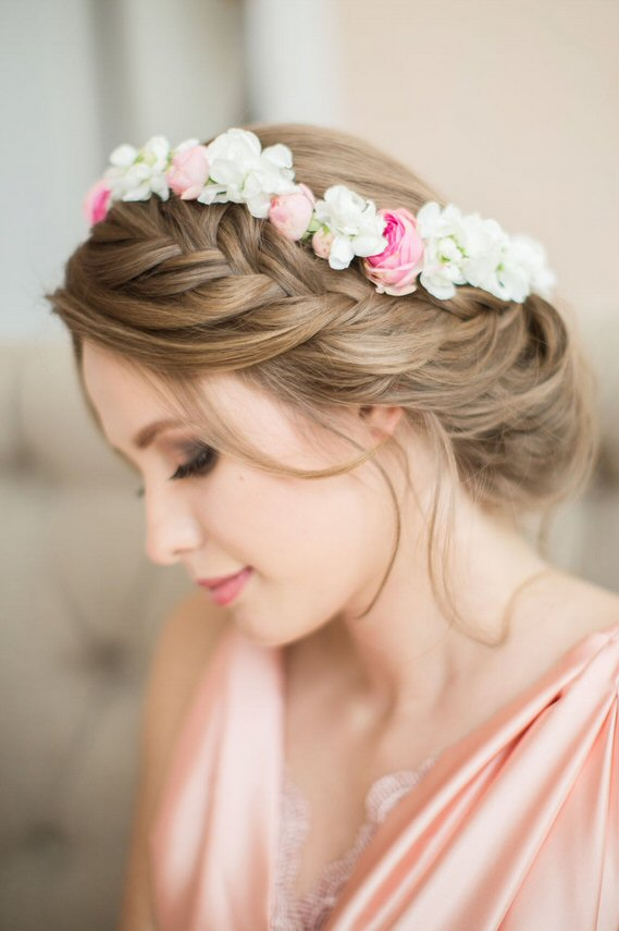 This low updo with braid - Day 20 in our 31 Days of Wedding Hairstyles series - is perfect for pairing with a hair crown.