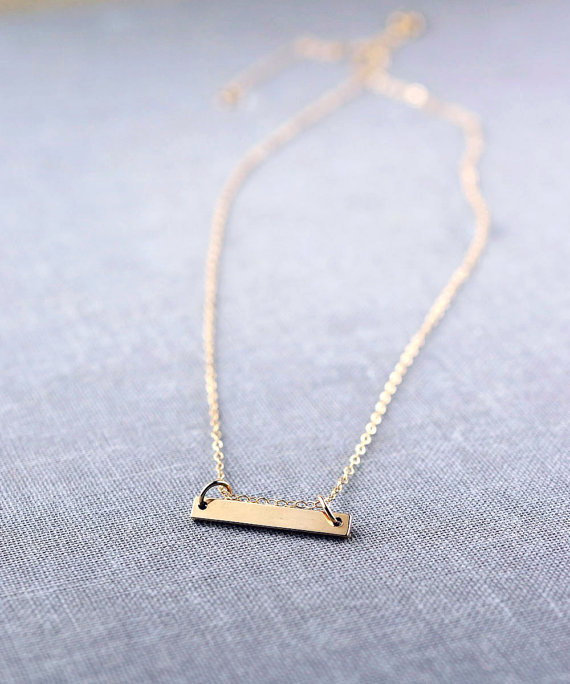 solid 14k gold bar necklace via 27 Amazing Anniversary Gifts by Year