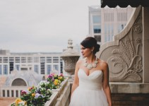 statement necklace worn by bride with sweetheart strapless gown