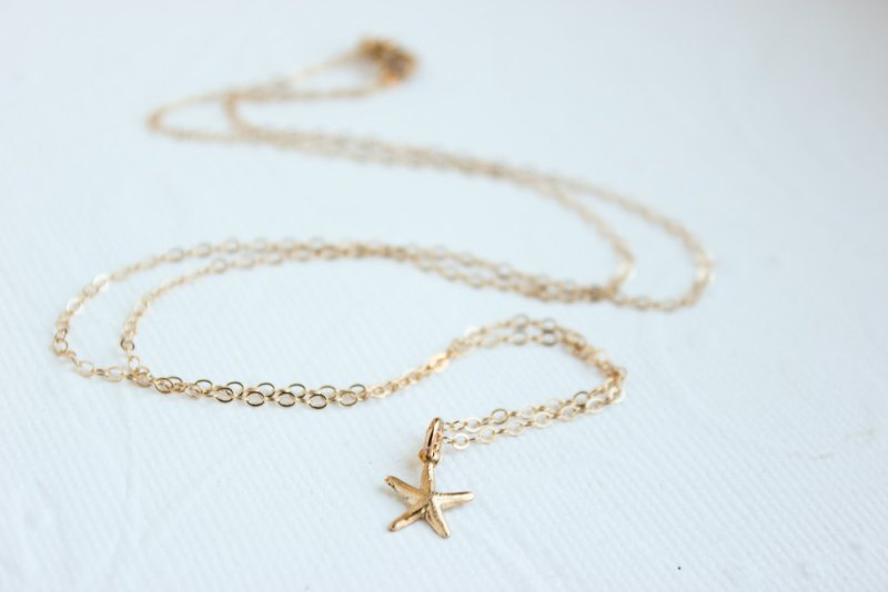 teeny starfish necklace | via starfish wedding ideas: http://emmalinebride.com/beach/starfish-wedding-ideas/