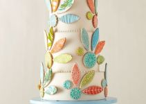 wedding cake with hand painted cookies