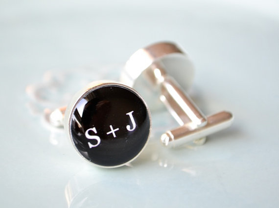 Gift your groom with a pair of cufflinks that include your wedding initials.