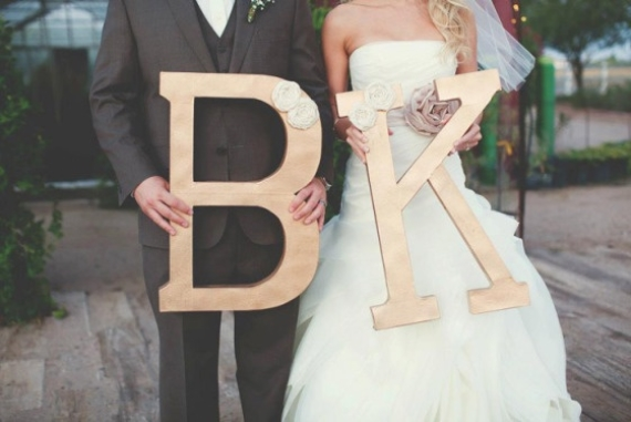 The couple used their wedding initials as a photograph, which can be printed as thank you cards after the wedding. (photo: jasmine amber)