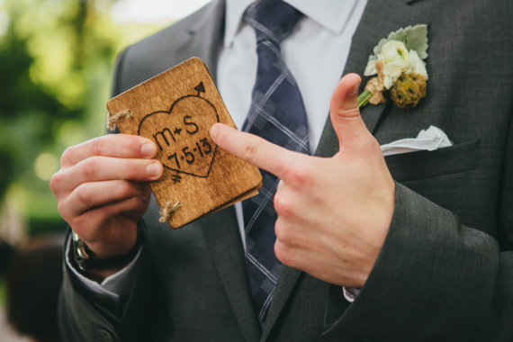 Write your vows in a rustic inspired vow book, like this one that features your wedding initials on the front.
