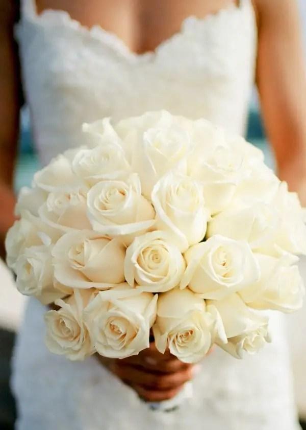 white rose wedding bouquet - photo: kjrsten madsen photography | rose bouquets weddings via http://emmalinebride.com/bouquets/rose-bouquets-weddings/