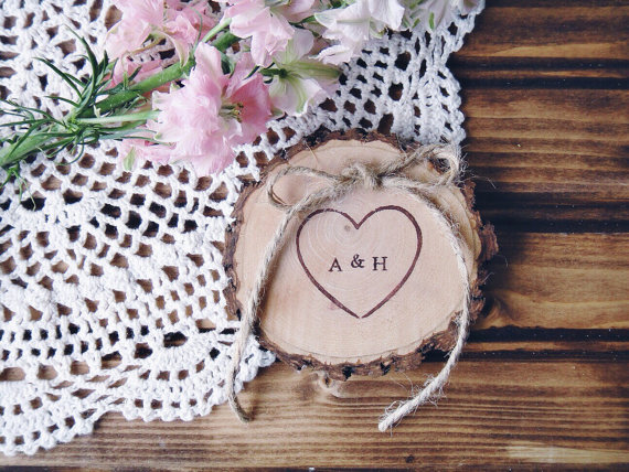 wood slice ring pillow with monogramed names burned on top