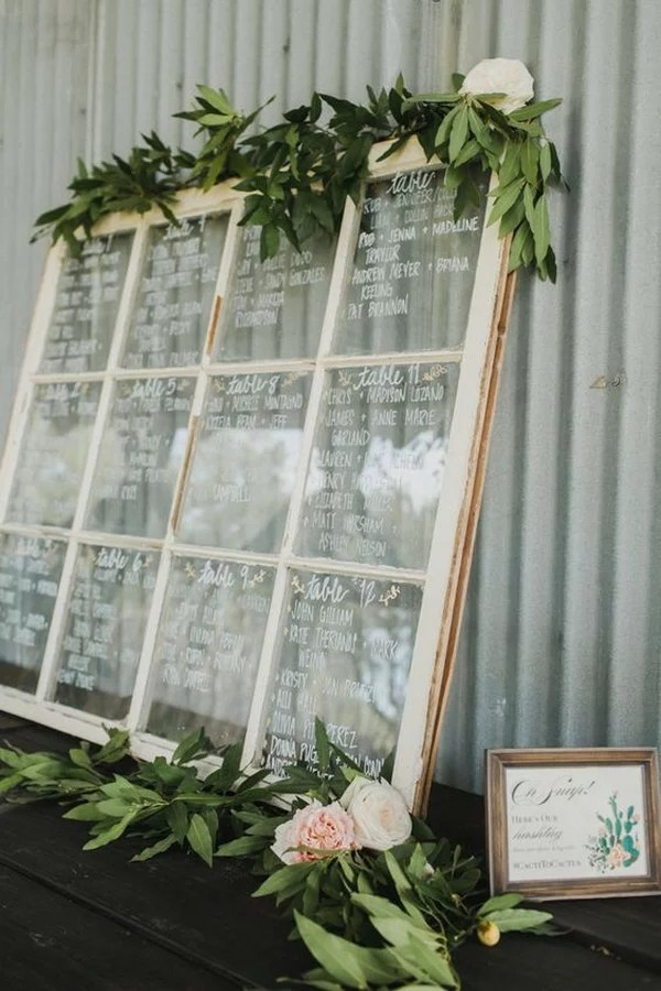 vintage window wedding seating chart with floral accented