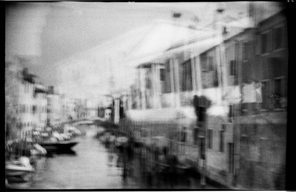 A double exposure made with a 60 year old box camera, somewhere near Venice.