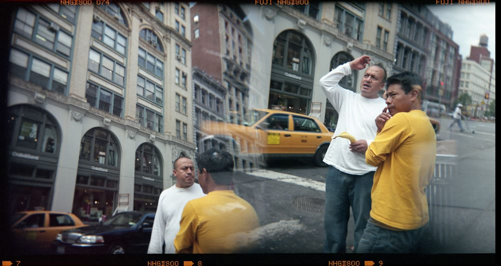 """Guys talking, New York City"" Holga superimposed in camera, Fuji NPZ 800"