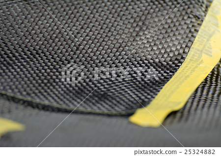 Carbon fiber composite material background - Stock Photo 25324882