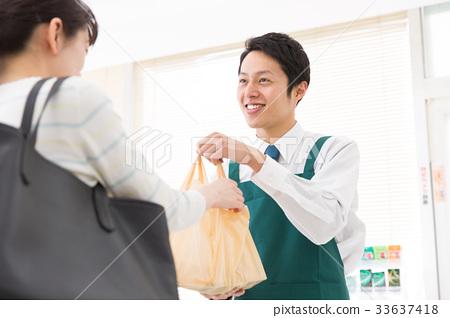 salesperson, shop assistant, Convenience Store - Stock Photo