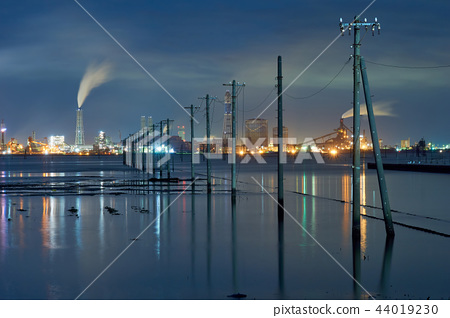 Egawa Coast telephone pole reflection and factory night view - Stock
