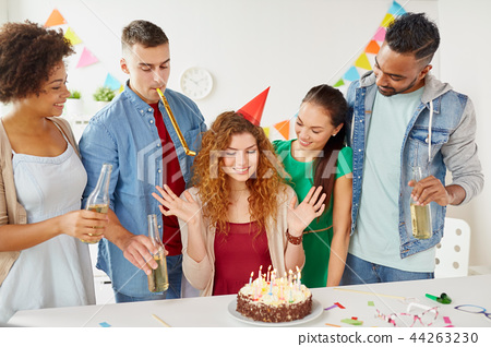happy coworkers with cake at office birthday party - Stock Photo