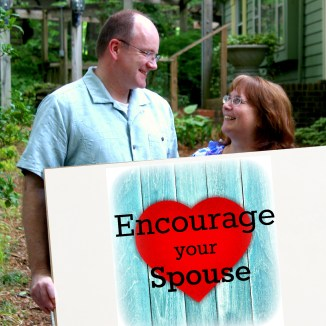 Rob and Lori Encourage Your Spouse sign logo