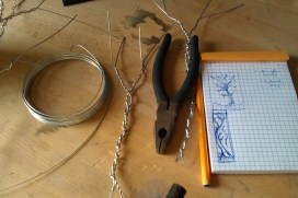 Marshalling the forces... Wire, pliers/clips, and a rough idea of what I'm trying to do.