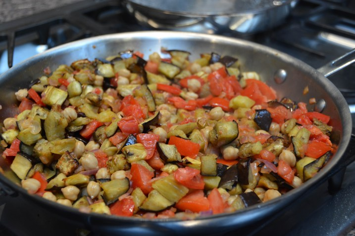 Sauté the eggplant, tomato and chickpeas