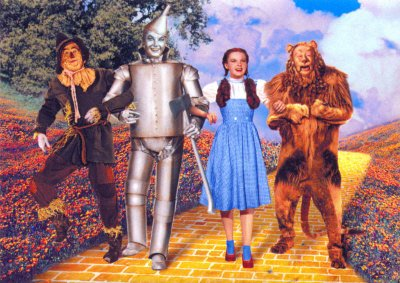 Scarecrow (Ray Bolger), Tin Man (Jack Haley), Dorothy Gale (Judy Garland) and Cowardly Lion (Bert Lahr),